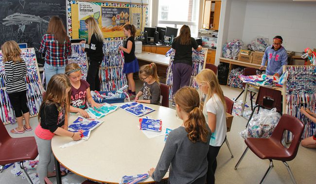 <p>Students at St. Patrick Catholic School enjoy spending their recess working on the Milk Bag Mat Project by cutting, tying and weaving more than 10,000 milk bags into child sized mats together to send overseas in Harrowsmith, Ont. on Monday June 13, 2016. The 230 students and organizers are looking to make 100 mats before the end of the school year. Julia McKay/The Whig-Standard/Postmedia Network