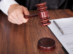 A judge strikes his gavel in a courtroom in this file photo. (AndreyPopov/Getty Images)