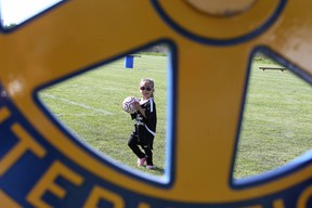 Three-year-old Mia Paquette tries out the new Rotary Park Soccer Fields  prior to the grand opening in Sudbury, Ont. The fields contain five mini soccer pitches. Gino Donato/Sudbury Star/Postmedia Network