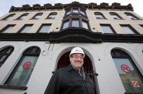 Vito Frijia, president of Southside Group, in front of 183 King St. (DEREK RUTTAN, The London Free Press)