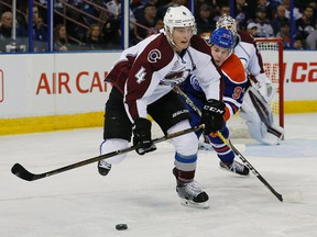 Tyson Barrie fights off Oilers centre Connor McDavid during a game last season. (Reuters)