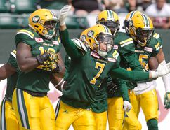 Edmonton Eskimos' Josh Woodman (7) of Chatham celebrates an interception against the Saskatchewan Roughriders in the second half Saturday in Edmonton. The Eskimos won 25-11 in the CFL pre-season game. (JASON FRANSON/The Canadian Press)