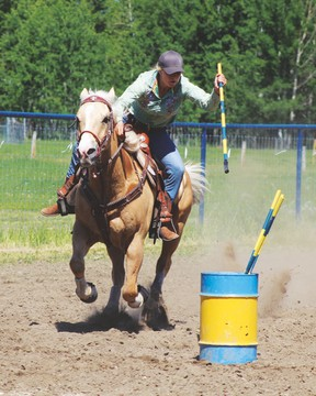 (L.) This rider is taking part in the Flag event that was part of the Golden Spur Gymkhana June 5. Polebending was another event held during the day.