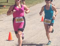 Nipissing Triathlon Club member Barbara Chartrand crosses the finish line for the Olympic event at the Subaru Provincial Triathlon Club Championships in Guelph this past weekend.