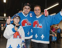 Fans of the former NHL team the Quebec Nordiques enjoy the atmosphere during the NHL pre-season game between the Montreal Canadiens and the Pittsburgh Penguins at the Videotron Centre on September 28, 2015 in Quebec City, Quebec, Canada. The Montreal Canadiens defeated the Pittsburgh Penguins 4-1. (Photo by Minas Panagiotakis/Getty Images)