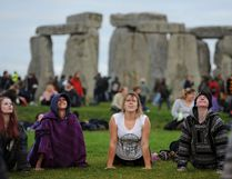 People perform yoga as they gather at the ancient stone circle Stonehenge, during the Summer Solstice, the longest day of the year, in Wiltshire Tuesday June 21, 2016. (Andrew Matthews/PA via AP) UNITED KINGDOM OUT, NO SALES, NO ARCHIVES