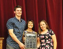 Jack Goerke and Megan Brown receive the Sue Fahey Trojan Excellence Award for outstanding contribution to Moira Trojans athletics. Sue Fahey, former longtime teacher-coach at MSS, presents the award named in her honour. (Submitted photo)