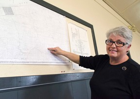 Debbie Bauer, one of the founding members of the East Ashfield History Book Committee, shows on a photocopy of an old map the location the book they are compiling information for will cover. (Darryl Coote/Reporter)
