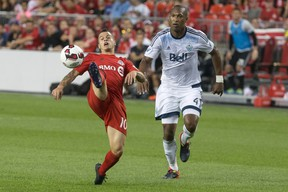Toronto FC's Sebastian Giovinco (left) controls the ball as Vancouver Whitecaps' Kendall Watson defends during the first leg of the Canadian Championship final at BMO Field on Tuesday night. (Chris Young/The Canadian Press)