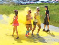 Photo by KEVIN McSHEFFREY/THE STANDARD These two women got more than just a dash of colour tossed at them when they crossed the finish line in the third Blind River Color Dash.