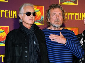 """In this Oct. 9, 2012 file photo, Led Zeppelin guitarist Jimmy Page, left, and singer Robert Plant appear at a press conference ahead of the worldwide theatrical release of """"Celebration Day,"""" a concert film of their 2007 London O2 arena reunion show, in New York. Led Zeppelin's lawyers asked a judge Monday, June 20, 2016, to throw out a case accusing the band's songwriters of ripping off a riff for """"Stairway to Heaven."""" (Photo by Evan Agostini/Invision/AP, File)"""