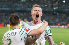 Ireland's James McClean, right, and Seamus Coleman celebrate at the end of their Euro 2016 match against Italy at the Pierre Mauroy stadium in Villeneuve d'Ascq, near Lille, France, Wednesday, June 22, 2016. (AP Photo/Michel Spingler)