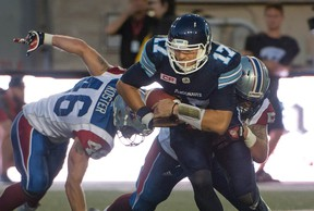Toronto Argonauts' Cody Fajardo tries to outrun the Montreal Alouettes defence during first-quarter CFL action in Montreal on June 17, 2016. (THE CANADIAN PRESS/Peter McCabe)