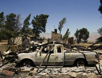 A pickup truck destroyed by a wildfire sits on a burned down property Friday, June 24, 2016, near Lake Isabella, Calif. The wildfire that roared across dry brush and trees in the mountains of central California gave residents little time to flee as flames burned homes to the ground, propane tanks exploded and smoke obscured the path to safety. (AP Photo/Jae C. Hong)