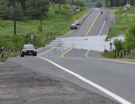 Police have closed off Veterans Dr. between Rabbit Lake Rd. and Villeneuve Rd. due to some flooding on June 25. DANELLE GRANGER/Daily Miner and News