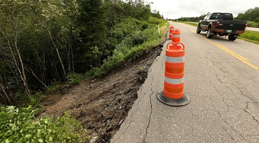 A truck passes a washout on Highway 301 east of Falcon Lake in Whiteshell Provincial Park on Sun., June 26, 2016. Kevin King/Winnipeg Sun/Postmedia Network