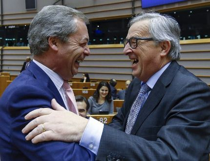 """Nigel Farage (L), Britain's UK Independence Party (UKIP) leader and European Commission President Jean Claude Juncker (R) take part in a plenary session at the European Parliament on the outcome of the """"Brexit"""" summit, in Brussels February 24, 2016. REUTERS/Yves Herman"""