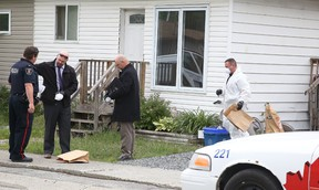 Greater Sudbury Police officers, detectives and forensic officers investigate a semi-detached home at 11B Peter St.  in Copper Cliff, Ont. on Sunday June 26, 2016. A 34-year-old man suffered life-threatening injuries during an altercation with a 31-year-old man from St. Charles who was arrested and charged with attempted murder. The injured male was transported to Health Sciences North, where he remains in critical but stable condition. Gino Donato/Sudbury Star/Postmedia Network