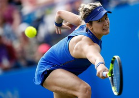 Canada's Eugenie Bouchard returns the ball to Poland's Agnieszka Radwanska during Day 3 of the 2016 Eastbourne International tennis tournament at Devonshire Park, Eastbourne, England, on June 22, 2016. (THE CANADIAN PRESS)