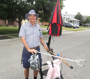 Using his walker and grabbing tools, Robert Charest has spent the last six years cleaning up litter from the streets and trails of the city's east end. He will be receiving a civic award for his effort. (Michael Lea/The Whig-Standard)