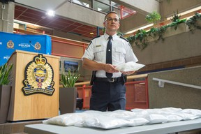 Edmonton Police Service Insp. Dwayne Lakusta at EPS Headquarters with 16 kilograms of seized cocaine and methamphetamine worth $900,000 on June 28, 2016. Police have charged Ho Tran, 47 with possession for the purpose of trafficking. Shaughn Butts / Postmedia Network
