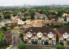 An explosion in Mississauga, Ont., levelled one home and severely damaged 24 others on Tuesday, June 28, 2016. One person is dead and several others injured. The cause of the blast has not yet been determined. (Stan Behal/Toronto Sun/Postmedia Network)