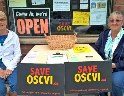 Gail Poupore, left, and Nancy Blair, volunteers with the SAVE OSCVI group, drum up support outside the group's storefront office in downtown Owen Sound Tuesday. (Scott Dunn/The Sun Times)