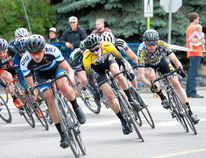 <p>RMCC racers Mitch Fennell middle, and James Kendal, right, take a corner in the Cat 3 race at the fifth annual Rundle Mountain Road Festival in downtown Canmore, Alta. on Saturday, June 25, 2016. Fennell placed 11th and Kendal placed 16th. Pam Doyle/For the Bow Valley Crag & Canyon
