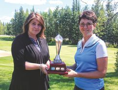 Andrea Pyper, left, presents Michele Ehret, with the Pepsi Seniors Classic title on Sunday June 26, 2016 at the Dunes Golf and Winter Club. Ehret recorded a score of 82. PHOTO BY PLAY PEACE COUNTRY GOLF