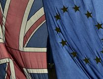 A British Union flag and a European Union flag hang from a building in central London, Britain February 18, 2016. (REUTERS/Toby Melville/File Photo)