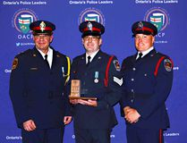 Insp. Rudy Jambrosic (left), Sgt. Brad Cotton and Const. Darryl Graham post with the Ontario Association of Chiefs of Police Award received by the Brantford police service. (Submitted Photo)