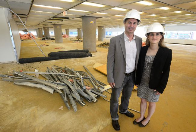 David Ciccarelli, chief executive of Voices.com and his wife Stephanie Ciccarelli, chief brand officer, look over their new office space in the Bell Building on Wednesday. (MORRIS LAMONT, The London Free Press)