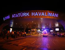 People gather at the entrance to Istanbul's Ataturk airport, early Wednesday, June 29, 2016. Two explosions have rocked Istanbul's Ataturk airport Tuesday, killing several people and wounding scores of others, Turkey's justice minister and another official said. A Turkish official says two attackers have blown themselves up at the airport after police fire at them. Turkish authorities have banned distribution of images relating to the Ataturk airport attack within Turkey. (AP Photo/Emrah Gurel)