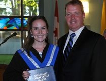 Darby Mallory accepts her graduation certificate from St. Mary Catholic High School principal J.P. Elliott during convocation exercises Wednesday. Mallory paid a return visit later to pick up the Principal's Award.