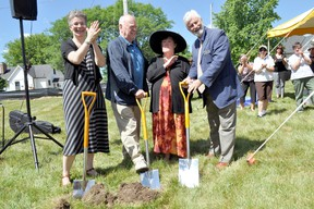 Marietta Drost, executive director of L'Arche London (left), L'Arche resident Janet Blair with her father Jim Blair (middle), and David McKane, campaign steering committee member, break ground on the future site of the L'Arche London Gathering Place in London Ont. June 29, 2016. CHRIS MONTANINI\LONDONER\POSTMEDIA NETWORK