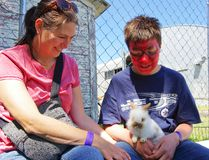 Tanya and Carter Vanstone (decked out in Spider-Man face paint) share a mother-son moment at the petting zoo June 25. The Miami Fair and Rodeo ran June 25-26, 2016. (Alexis Stockford/The Morden Times)