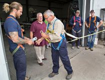 Safety instructor Adam Fernley (second from left) watches electrician Ed Hovestadt (centre) execute a training procedure using a double-leg lanyard to maintain a tie-off at all times during a session at RBT Electrical and Automation near Paris. Tradesmen at the company took part in a 6.5-hour program to be trained and certified under new Working At Heights standards, required for all who work at heights greater than 10 feet. (Brian Thompson/The Expositor)