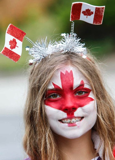 Now thats Canadian. The rain didn't hamper the East York Canada Day Parade as people came out in droves to have some fun on Cosburn Ave. in Toronto on Friday July 1, 2016. Dave Thomas/Toronto Sun/Postmedia Network