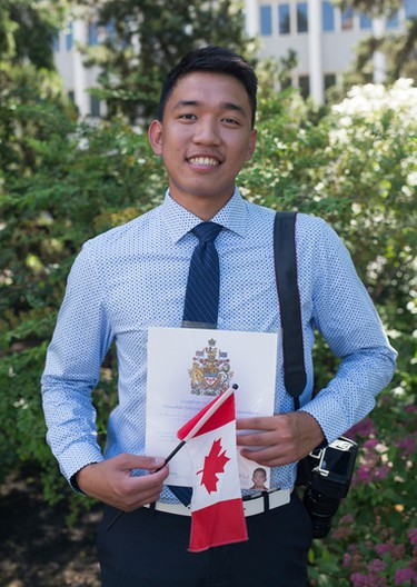 EDMONTON ALBERTA: July 1, 2016 Virgil Malabanan, 21, from Philippines, after being sworn in as a new citizen during Canada Day festivities at the Alberta Legislature in Edmonton July 1, 2016. AMBER BRACKEN/EDMONTON JOURNAL