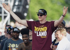In this Wednesday, June 22, 2016 photo, Cleveland Cavaliers' Timofey Mozgov acknowledges the crowd during a rally in Cleveland. (AP Photo/Tony Dejak)