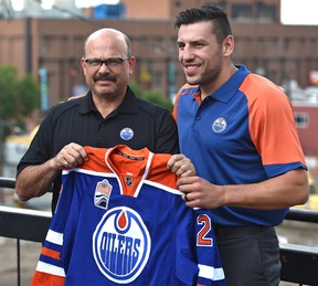 Newly acquired forward, Oiler Milan Lucic and GM Peter Chiarelli before talking to the media in Edmonton, Friday, July 1, 2016.