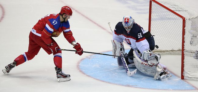 Russia's Alexander Radulov scores on Slovakia's goalie Jan Laco in the shootout at the 2014 Winter Olympics in Sochi, Russia, on Sunday February 16, 2014. (Postmedia Network file photo)