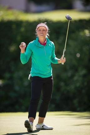Brooke Henderson of Smiths Falls celebrates after winning an LPGA tournament in Portland, Ore., on Sunday. (The Associated Press)