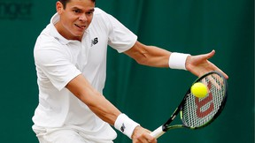 Milos Raonic of Canada returns to David Goffin of Belgium during their men's singles match on day eight of the Wimbledon Tennis Championships in London, Monday, July 4, 2016. (AP Photo/Ben Curtis)