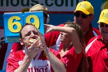 Joey Chestnut competes in Nathan's Famous Fourth of July International Hot Dog Eating Contest men's competition, Monday, July 4, 2016, in New York. Chestnut came in first eating 70 hot dogs and buns in 10 minutes. Matt Stonie came in second eating 53 hot dogs and buns in 10 minutes. (AP Photo/Mary Altaffer)