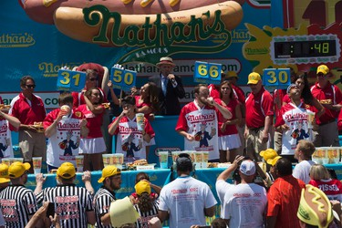 Matt Stonie, second from left, and Joey Chestnut, second from right, compete in Nathan's Famous Fourth of July International Hot Dog Eating Contest men's competition, Monday, July 4, 2016, in New York. Chestnut came in first eating 70 hot dogs and buns in 10 minutes. Stonie came in second eating 53 hot dogs and buns in 10 minutes. (AP Photo/Mary Altaffer)