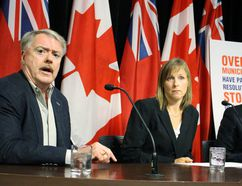 From left, Sarnia Mayor Mike Bradley, Keep Hydro Public spokesperson Katrina Miller and Whitby Councillor Chris Leahy call for a larger public debate on the partial sale of Hydro One during a Queen's Park media conference on Monday September 28 2015. Antonella Artuso/Toronto Sun/Postmedia Network