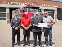 Enbridge Gas Distribution has partnered up with the Fire Marshal's Public Fire Safety Council to help the Laurentian Valley Fire Department purchase firefighting training materials, by donating $5,000. In the photo are, starting from left, Scott Hayes, fire protection adviser, Office of the Fire Marshal and Emergency Management, Laurentian Valley Township Mayor Steve Bennett, Laurentain Valley Fire Chief Tim Sutcliffe, and Andre Gaudette, area operating supervisor, Enbridge Gas.