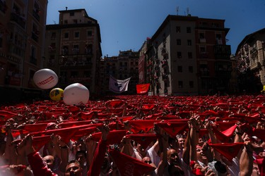 Revelers hold up traditional red neckties during the launch of the 'Chupinazo' rocket, to celebrate the official opening of the 2016 San Fermin festival in Pamplona, Spain, Wednesday, July 6, 2016. Revelers from around the world turned out here to kick off the festival with a messy party in the Pamplona town square, one day before the first of eight days of the running of the bulls. (AP Photo/Daniel Ochoa de Olza)