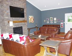 The completed living room of Katie's Cottage just east of the Boundary Trails Health Centre. A memory wall and quilt with the Katie Cares motto are visible. (Alexis Stockford/The Morden Times)